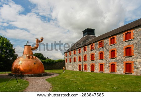 CORK, IRELAND - JUNE 20, 2008:  Old big copper whiskey distillery on stone foundation at the Jameson Heritage Center  in Midleton Co. Cork, 12 miles east of Cork City on the main Cork Waterford Road.  - stock photo