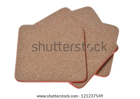 Cork mat with red border isolated on white background - stock photo