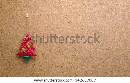Cork message board with hanging red christmas tree