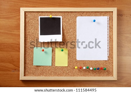 Cork message board with various paper notes
