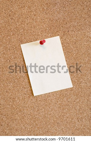 Cork noticeboard with a color note