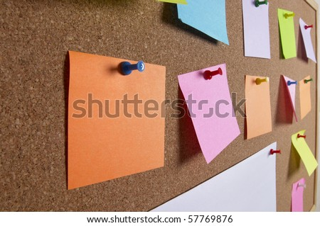 Cork office notice board with blank colorful sticker notes macro shot background
