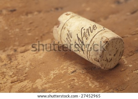 cork placed on woody surface with sign wine on it - stock photo