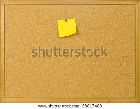 Cork posting board with blank note - stock photo