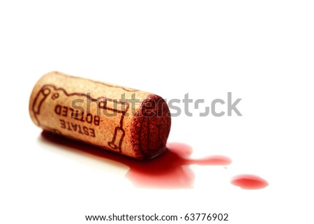 "cork, stamped ""Estate Bottled"" in puddle of red wine - stock photo"