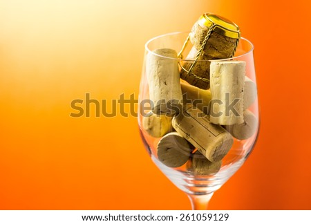 Cork stoppers in wine glass - stock photo