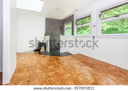 Cork tile floor installed and swept clean - stock photo