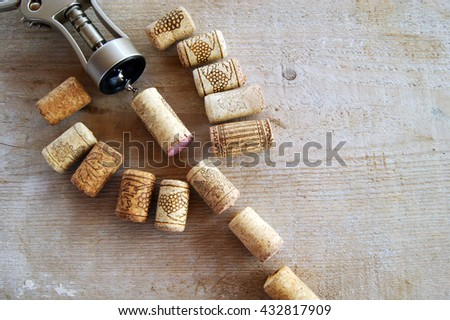 Cork wine with the corkscrew on a wooden background. Close-up - stock photo