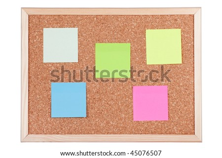 Corkboard with empty coloured notes, isolated on white background.