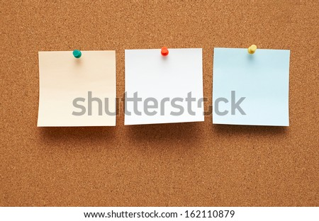 Corkboard with notes - stock photo