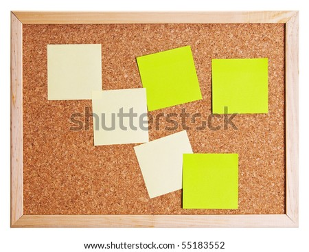 Corkboard with notes and business cards. - stock photo