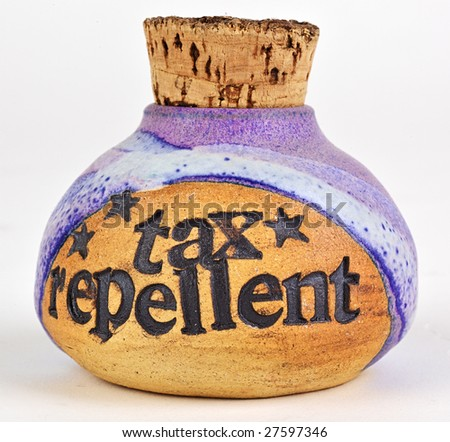 """Corked bottle labeled, """"tax repellent"""". Clipping path. - stock photo"""