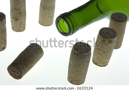 Corks gathered around neck of green wine bottle