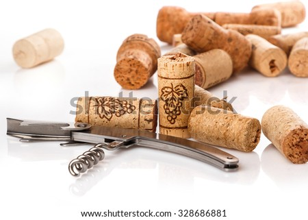 Corkscrew and corks on white background - stock photo