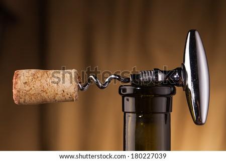 corkscrew  and wine bottle   - stock photo