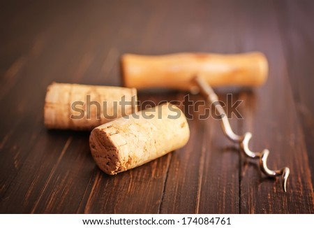 Corkscrew for wine and cork - stock photo