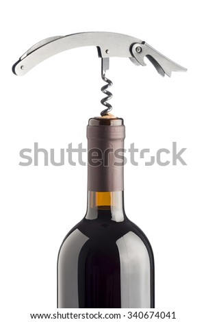 corkscrew inserted on cork into red wine bottle, isolated on white background - stock photo
