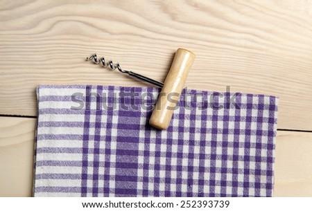 Corkscrew on wooden background - stock photo