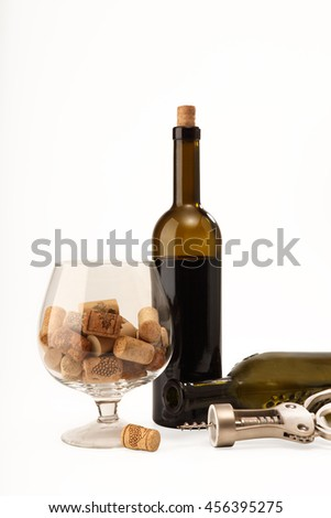 Corkscrew, wineglass, corks and bottle of wine for your design. Isolated on white background - stock photo