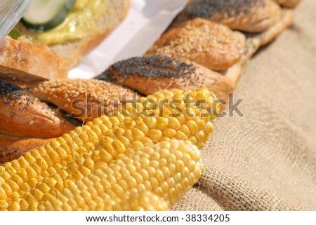 Corn and bread at the street market - stock photo