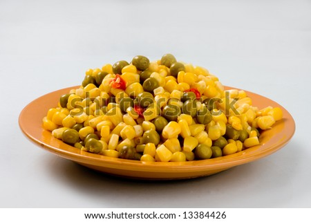 Corn and green peas with  pepper - stock photo