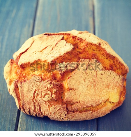 corn bread on blue wooden background - stock photo