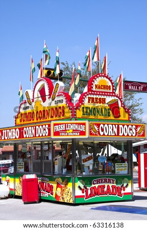 corn dog and lemonade concessions stand at a carnival - stock photo