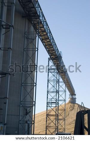 Corn elevator conveyor to a surplus pile - stock photo