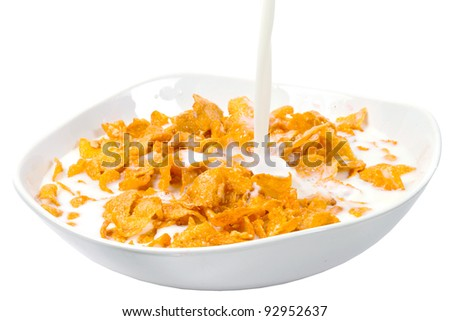 Corn flakes and milk for healthy breakfast - stock photo