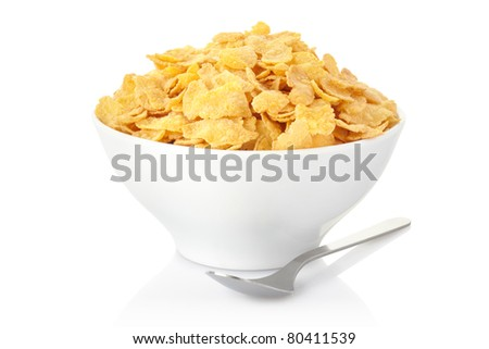 Corn flakes bowl and spoon isolated on white, clipping path included - stock photo