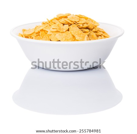 Corn flakes breakfast cereal in a white bowl over white background - stock photo