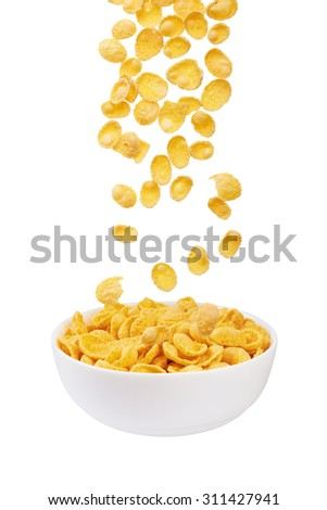 Corn flakes falling in bowl isolated on white background - stock photo