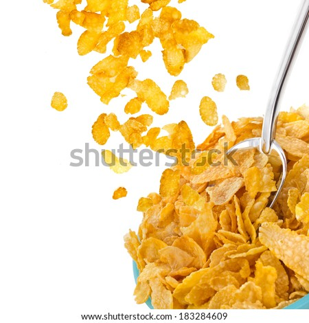 corn flakes falling in to bowl isolated on the white backgound  - stock photo