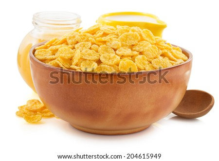 corn flakes in bowl isolated on white background - stock photo