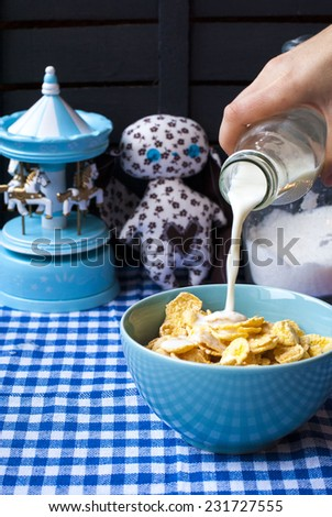 Corn flakes with milk for breakfast