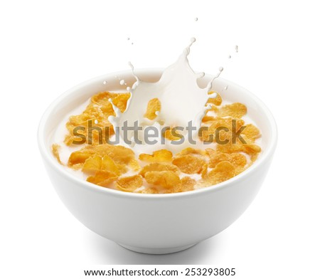 corn flakes with milk splash isolated on white - stock photo
