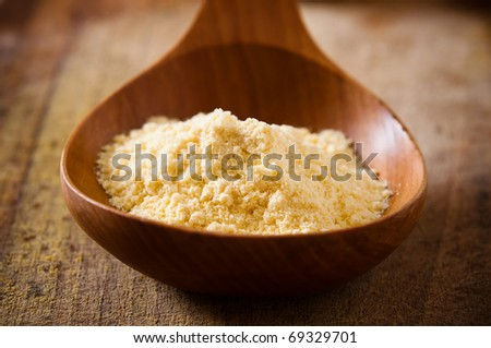 corn flour in a wooden spoon - stock photo