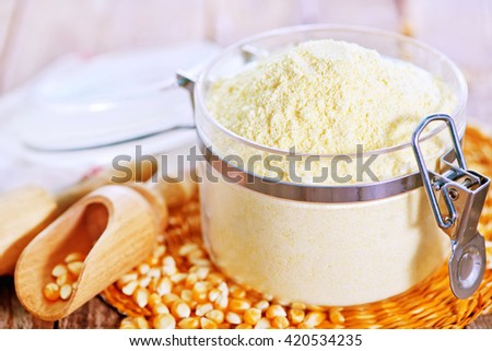 corn flour in glass bank and on a table