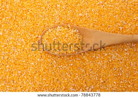 corn grits and spoon - stock photo