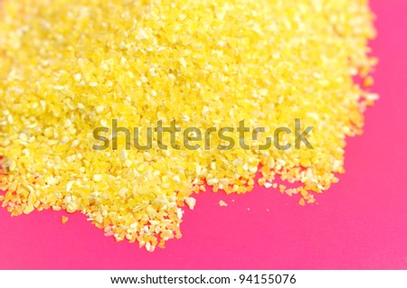 Corn Grits on Pink Background - stock photo