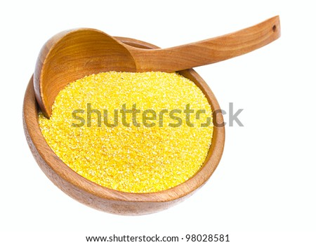 corn grits on wooden spoon, isolated on a white background - stock photo