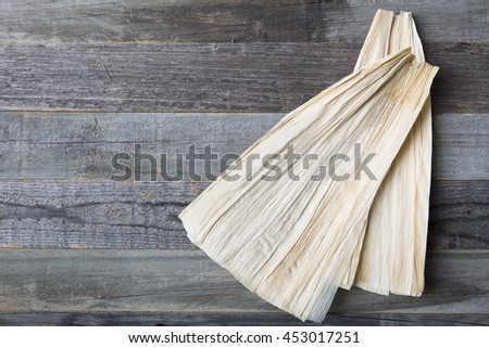 Corn  husks on weathered wooden surface with copy space.