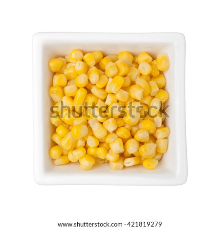 Corn kernels in a square bowl isolated on white background - stock photo