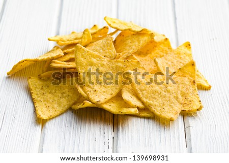 corn nachos on wooden table - stock photo