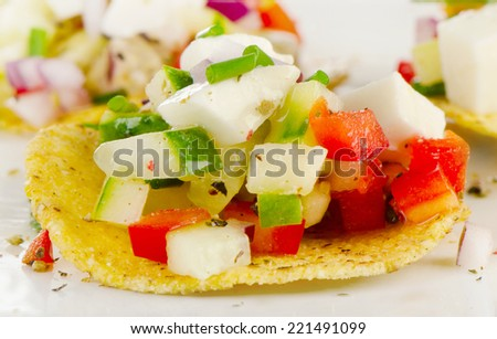 Corn nachos with vegetables and feta. Selective focus - stock photo