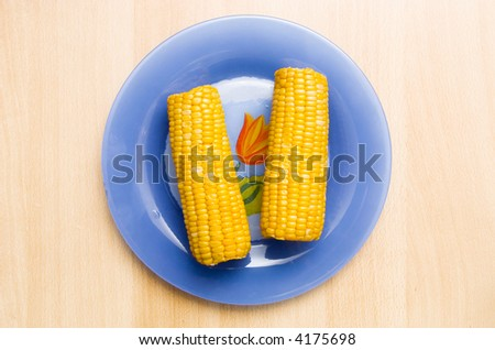 Corn on a plate. Top view. - stock photo
