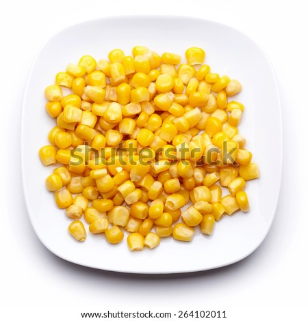 Corn on a white plate isolated on white. Top view. - stock photo