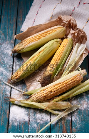 Corn on the wooden table. Rustic kitchen. - stock photo