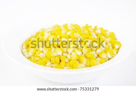 corn seeds in white bowl - stock photo