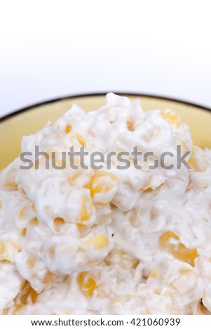 Corn sesame salad in the bowl with spoon.